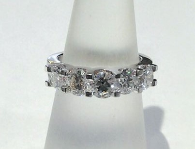 White gold diamond band with 5 large round diamonds.